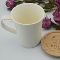 Cute emboss character designed ceramic milk coffee mug with wood lid for kids