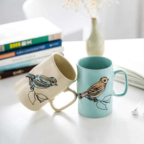 Hand-painted ceramic cups with flower and bird patterns